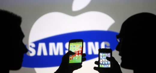 Men are silhouetted against a video screen as they pose with Samsung Galaxy S3 and iPhone 4 smartphones in this photo illustration taken in the central Bosnian town of Zenica, May 17, 2013. Overtaking Apple Inc as the world's leading maker of smartphones has stretched Samsung Electronics Co's in-house supply lines, and the South Korean firm is now courting some of its rival's main parts suppliers as they jostle to rule the $253 billion smartphone market.   REUTERS/Dado Ruvic (BOSNIA AND HERZEGOVINA - Tags: BUSINESS TELECOMS)